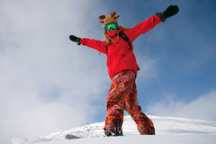 Snowboarder doing a toe side carve Royalty Free Stock Images