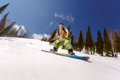 Snowboarder doing a toe side carve Royalty Free Stock Photography
