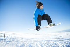 Snowboarder doskakiwanie Obrazy Royalty Free