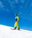 Snowboarder down hill, snow mountains snowboarding Royalty Free Stock Photos
