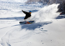 Snowboarder on the downhill Royalty Free Stock Photography