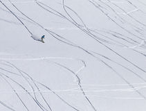 Snowboarder downhill on off piste slope with newly-fallen snow Stock Photography