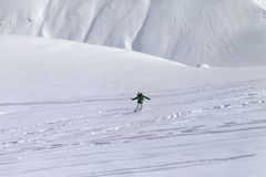 Snowboarder downhill on off piste slope with newly-fallen snow Royalty Free Stock Photo