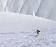 Snowboarder downhill on off piste slope with newly fallen snow Stock Photography
