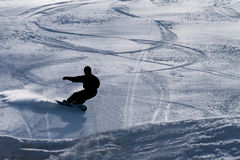 Snowboarder on a downhill run Royalty Free Stock Images