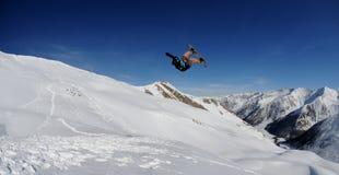Snowboarder em alpes de France Fotos de Stock