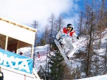 Snowboarder em um ar grande Foto de Stock Royalty Free