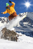 Snowboarder en alta montaña Fotografía de archivo libre de regalías