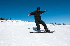 Snowboarder en el ir Foto de archivo libre de regalías
