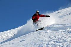 Snowboarder en la colina Imágenes de archivo libres de regalías