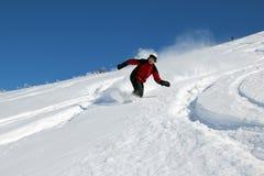 Snowboarder en la colina Fotografía de archivo libre de regalías