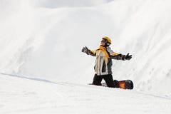 Snowboarder en la nieve Fotos de archivo