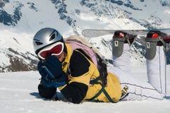 Snowboarder en las montañas Foto de archivo