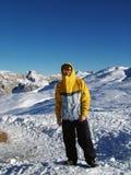 Snowboarder en las montañas Fotografía de archivo libre de regalías