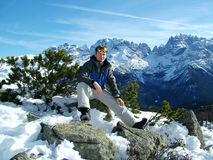 Snowboarder en las montañas Fotografía de archivo