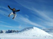 Snowboarder en las montañas Imágenes de archivo libres de regalías