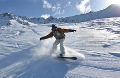 Snowboarder en nieve del polvo imágenes de archivo libres de regalías