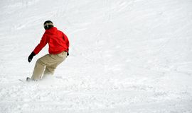 Snowboarder en nieve. Porciones de espacio Fotos de archivo libres de regalías