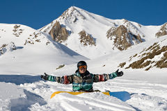Snowboarder enjoying powder snow Stock Photo