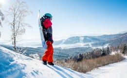 Snowboarder exploring snowy mountains Royalty Free Stock Photo