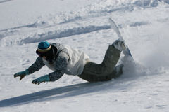 Snowboarder falling. Unsuccessful trick on the slope Royalty Free Stock Images