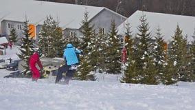 Snowboarder falls on ski slope stock video footage