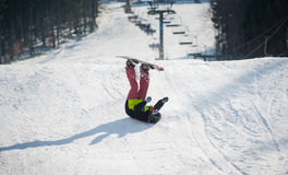 Snowboarder falls on the slopes during the descent Royalty Free Stock Photos
