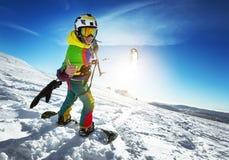 Snowboarder feliz da senhora com papagaio da neve Imagem de Stock Royalty Free
