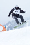 Snowboarder fly. In downhill race Stock Photography