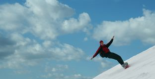 Snowboarder flying Stock Photography