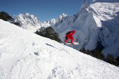 Snowboarder Flying In The Mountains Stock Photo