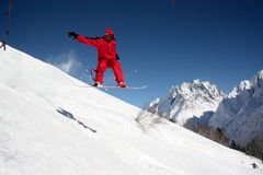 Snowboarder Flying In The Mountains Royalty Free Stock Photography