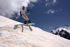 Snowboarder Flying In The Mountains Royalty Free Stock Photo