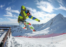 Snowboarder in the free jumping Stock Image