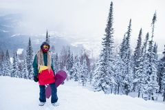 Snowboarder freerider woman on a snowy slope in mountains. Sport. royalty free stock photography