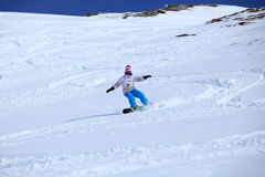 Snowboarder freeriding. Female snowboarder riding in fresh powder, Laax Switzerland Stock Images