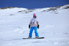 Snowboarder freeriding. Female snowboarder riding in fresh powder, Laax Switzerland Royalty Free Stock Photography