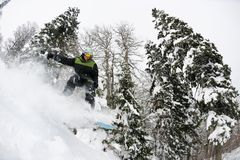 Snowboarder on fresh deep snow Stock Photos