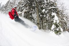 Snowboarder on fresh deep snow Royalty Free Stock Images