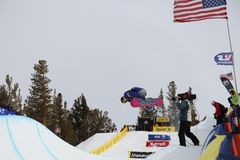 Snowboarder getting filmed at the half-pipe competition, Mammoth Mountain, California USA. Professional skiers and snowboarders get some air gravity defying Stock Photos