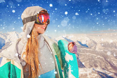 Snowboarder girl at Alps, Swiss mountain. Winter activities Royalty Free Stock Photos
