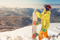 Snowboarder girl on the background of high mountain Alps, Switzerland Royalty Free Stock Images
