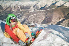 Snowboarder girl on the background of high mountain Alps, Switzerland Royalty Free Stock Image