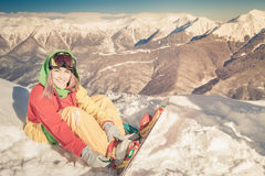 Snowboarder girl on the background of high mountain Alps, Switzerland Stock Photos