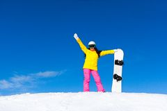 Snowboarder girl raised arms standing hold Stock Image