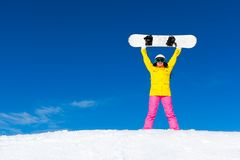 Snowboarder girl raised arms standing hold Royalty Free Stock Photography
