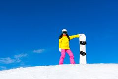 Snowboarder girl standing hold snowboard, snow Stock Images