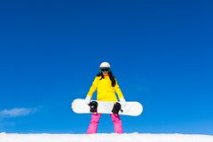 Snowboarder girl standing hold snowboard, snow Stock Image