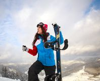 Snowboarder girl in winter get reach to the top of mountain Royalty Free Stock Photos