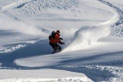 Snowboarder go down on powder snow. Royalty Free Stock Image